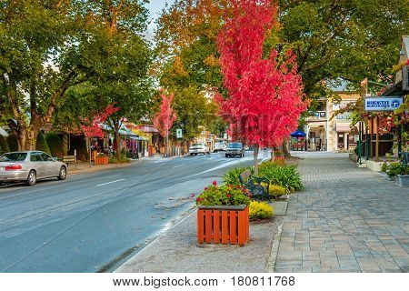 Hahndorf South Australia - April 9 2017: Main street views of Hahndorf in Adelaide Hills area with shops and cafes during autumn season after rain