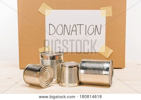 Tin Cans With Cardboard Donation Sign Donation On Wooden Table On White, Donation Concept
