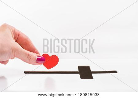 Close-up Partial View Of Woman Inserting Red Heart Symbol Into Hole For Donations In Form Of Cross,