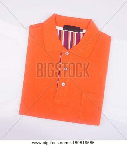 Shirt Or Mens Folded Polo Shirt On Background.