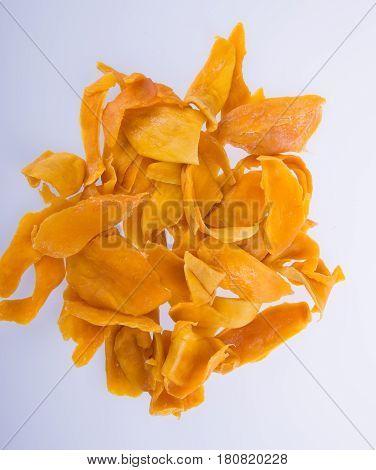 Mango Dry Or Dried Mango Slices On Background.