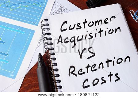 Customer Acquisition vs Retention Costs written in a note.
