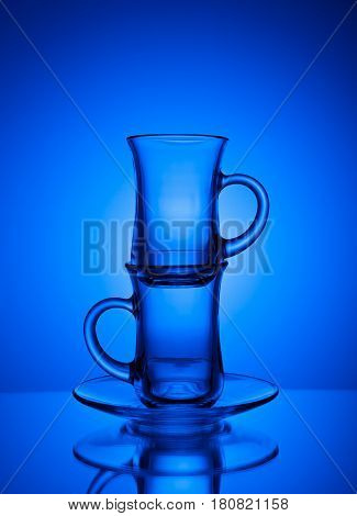 Beautiful glass tea cup on a blue background