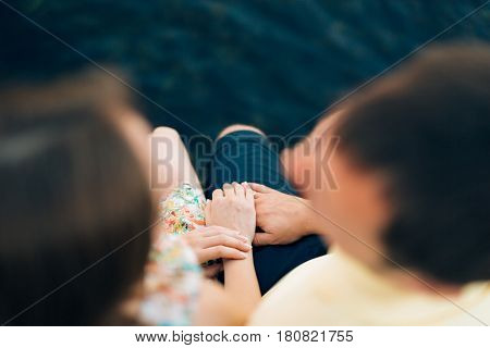 Newlyweds hold hands on the sea. Couple holding hands. Wedding in Montenegro.