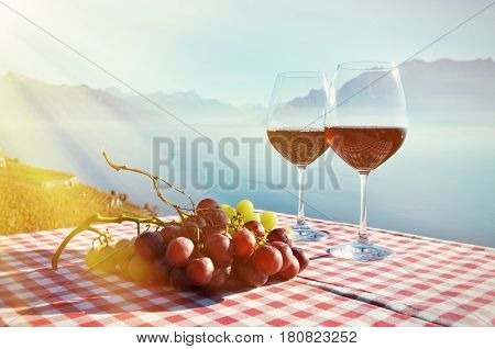 Wine and grapes against Geneva lake, Switzerland