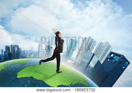 Happy Asian Business Woman Running On Big Earth