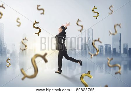 Happy Asian Business Woman With Falling Money Around Her