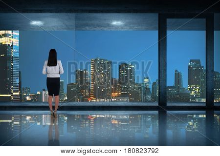 Back View Of Asian Business Woman Standing Looking At The City