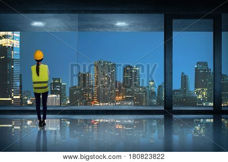 Young Asian Engineer Woman Standing Seeing Through Window Glass