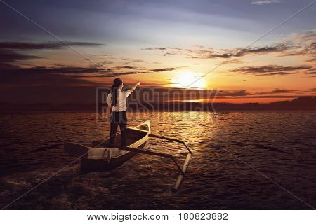 Beautiful Asian Business Woman Standing And Pointing To The Sun