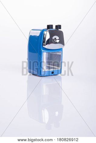 Pencil Sharpener Or Blue Pencil Sharpener On Background.