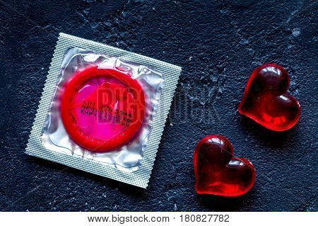 concept male contraception condom on dark background top view.