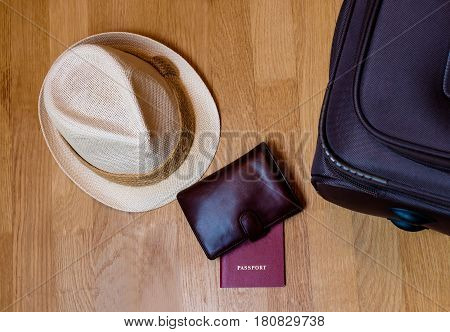 Travel accessories. Hat wallet passport suitcase prepared for the trip