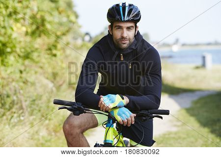 ready set go Seriously cycling man in helmet portrait