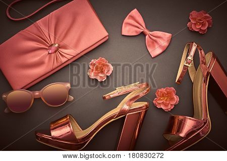 Fashion Design Woman Accessories Set. Trendy fashion Sunglasses, Handbag Clutch. Glamor Metallic Pink Fuchsia fashion shoes Heels, Flower. Luxury Shiny Party Night Out lady on Black. Art. Minimal