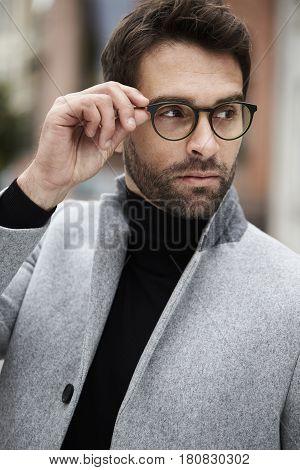 Handsome Man wearing eyeglasses and looking away