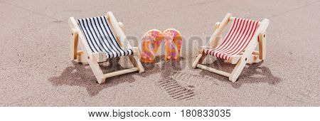 Two colorful sun loungers on the beach
