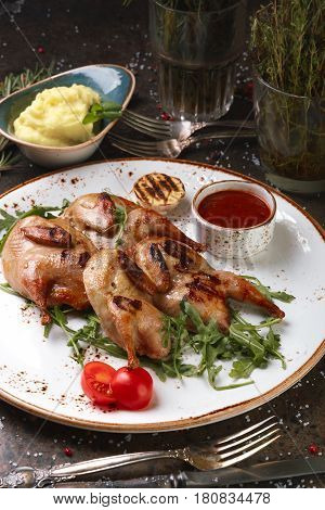 Two Quail Grills With Mashed Potatoes And Arugula