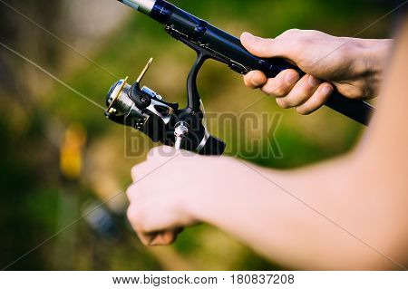 hands angler on a river with spinning