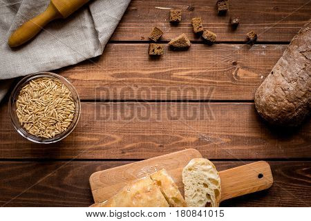 bakery concept with homemade fresh wheat bread on rustic kitchen table background top view moke-up