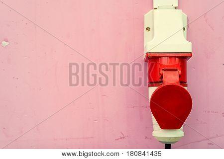 Close-up shot of industrial plug put into socket