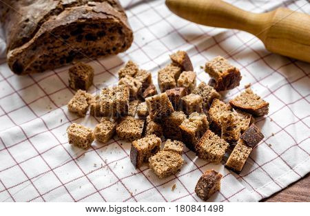 Baking bread ingredients with rolling-pin at home kitchen on wooden table background