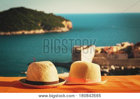 two hats on vacation in Croatia, Europe, travel concept