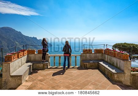 Ravello Italy - April 6 2011: Young ladies looking at the panorama from Villa Rufolo