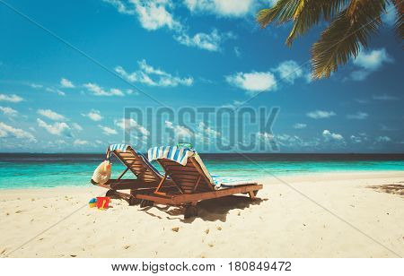 Two beach chairs on tropical vacation in Maldives