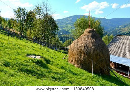 Haystack.  Landscape in Apuseni Mountains, Transylvania. The Apuseni Mountains is a mountain range in Transylvania, Romania, which belongs to the Western Romanian Carpathians