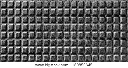 Shiny black texture of synthetic foamy material with parallel rows. Abstract background.