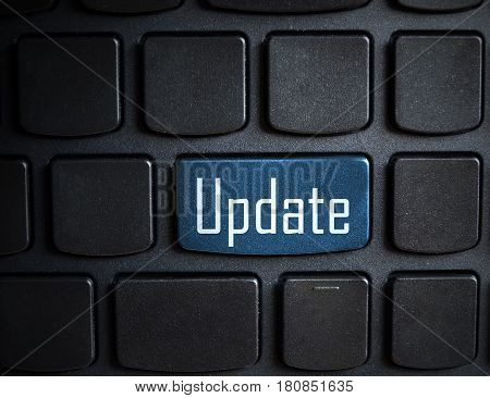 Computer notebook keyboard with Update key - technology background