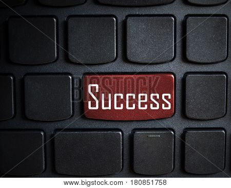 Keyboard with red Success button - business background