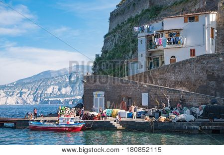 Sorrento Italy - November 15 2015: Fishermen and tourists in Marina Grande