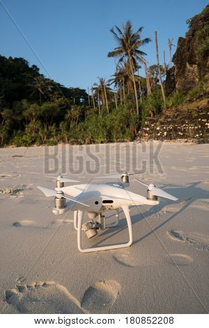 Closeup drone on sandy beach over beautiful summer blue sky and tropical island background
