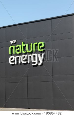 Odense, Denmark - April 9, 2017: NGF Nature energy logo on a wall. NGF Nature Energy provides gas storage, distribution and transmission services in Denmark
