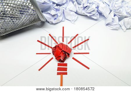 Crumpled paper light bulb metaphor for good idea. Inspiration concept