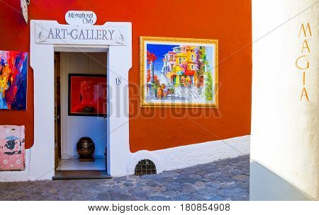 Positano Italy - April 19 2007: A full color art shop in the old town