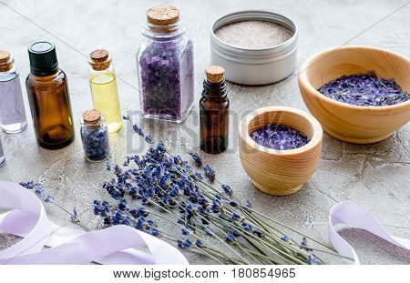 organic cosmetics with lavender on wooden background.