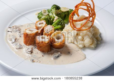 Chicken Cordon Bleu On A Plate With Rustic Mashed Potatoes.