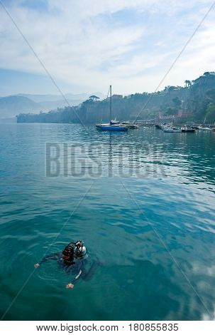 Sorrento Italy - March 23 2008: A diver in the harbor