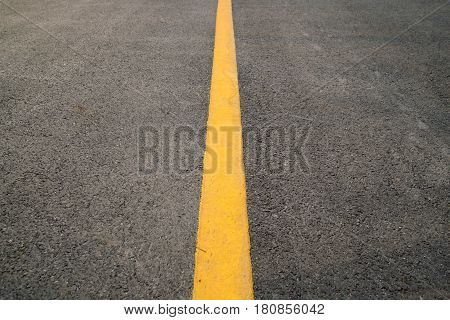 erspective Yellow straight Traffic line on road floor texture and background