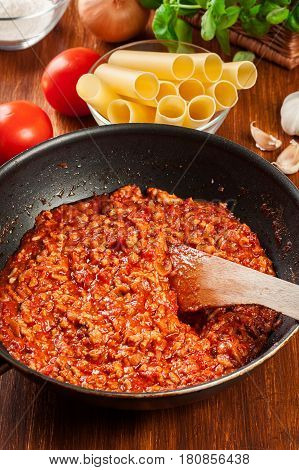Minced Meat Fried In Tomato Sauce In The Frying Pan. Preparation Cannelloni
