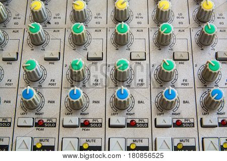 Old buttons equipment in audio Mixing Console. Close-Up View.