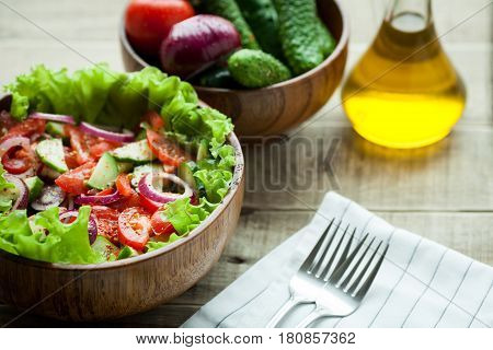 Rustic Salad Of Fresh Tomatoes, Cucumbers, Red Onions And Lettuce, Dressed With Olive Oil And Ground