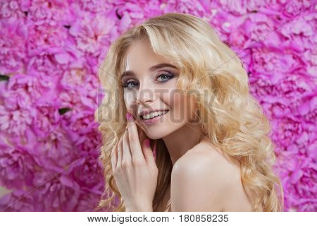 Beauty Woman On A Floral Background .