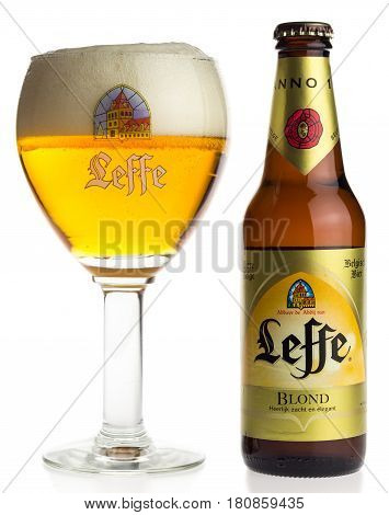 GRONINGEN, NETHERLANDS - APRIL 07, 2017: Bottle and glass of Belgian Leffe Blond beer isolated on a white background
