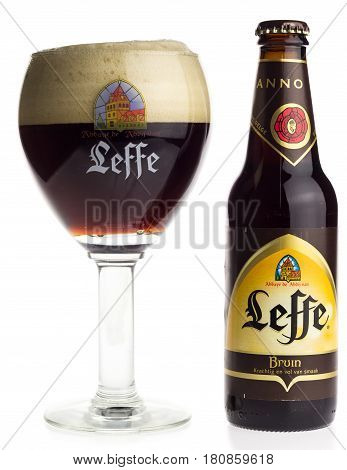 GRONINGEN, NETHERLANDS - APRIL 07, 2017: Bottle and glass of Belgian Leffe Bruin beer isolated on a white background