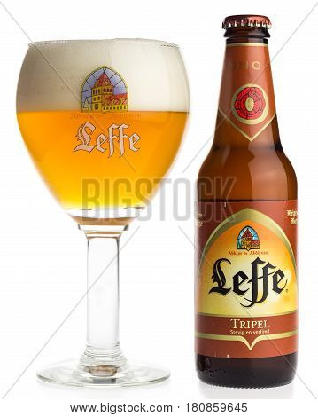 GRONINGEN, NETHERLANDS - APRIL 07, 2017: Bottle and glass of Belgian Leffe Tripel beer isolated on a white background