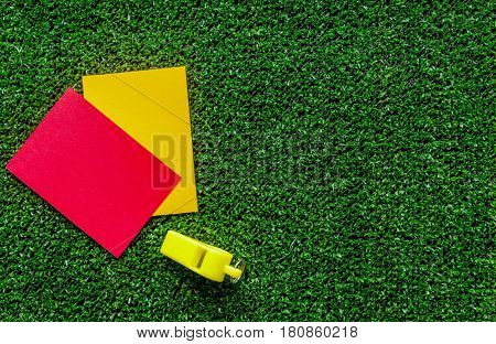 red and yellow cards on green background top view mock up